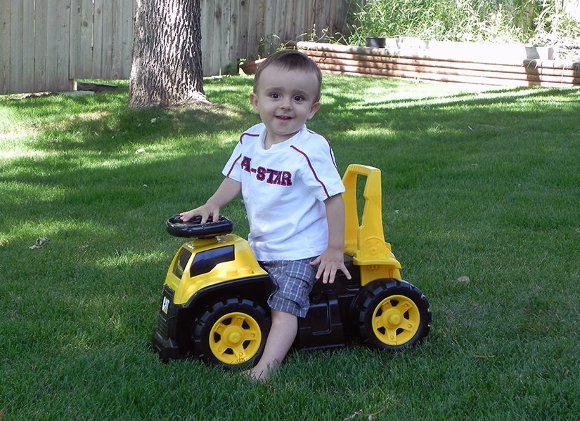 Young Levi on a scoot along toy