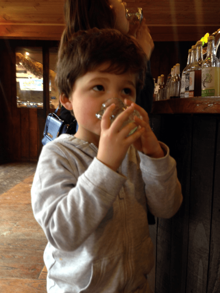 Isaac drinking from a glass