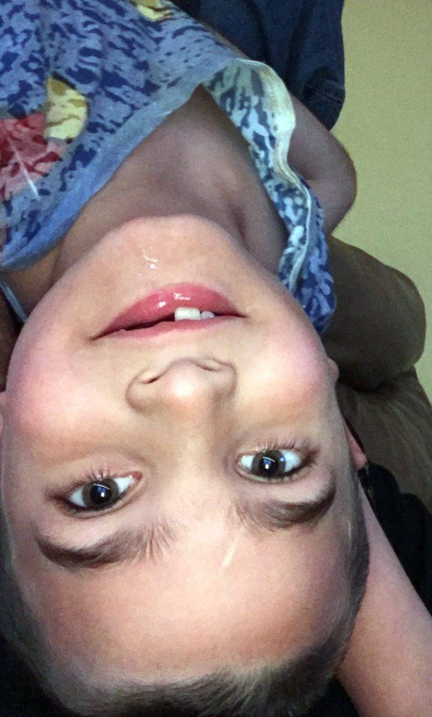 Elijah upside down, smiling