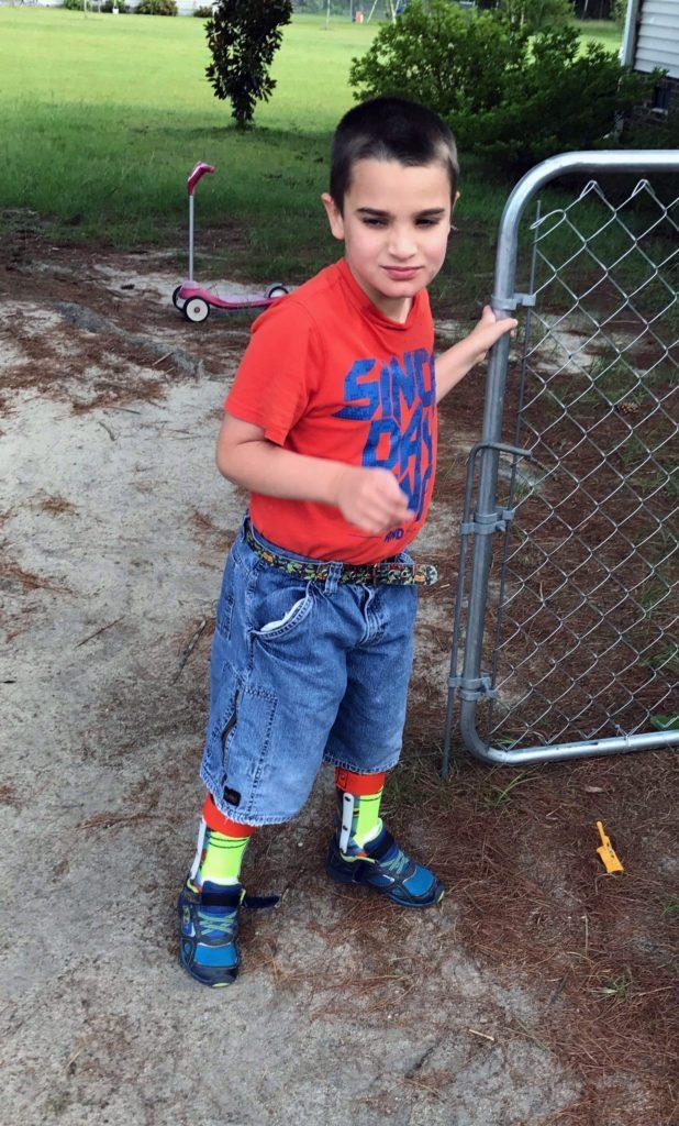 Elijah holding gate