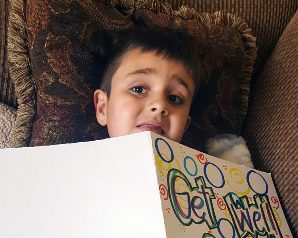Levi reading a get well soon card