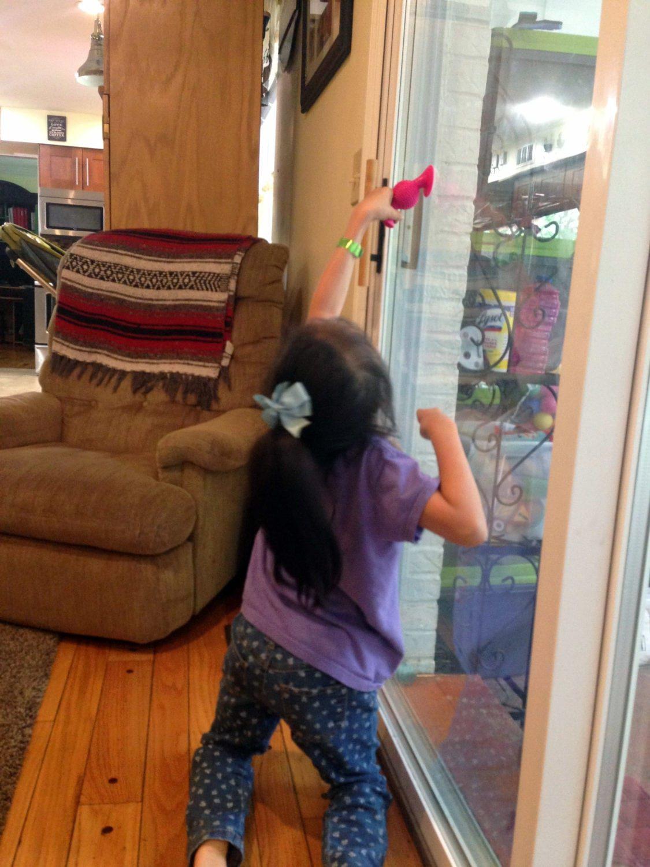 Standing at Glass Door
